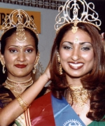 Subrina, being crowned by the outgoing queen Amrita
