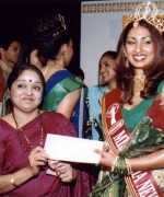Subrina, receiving her round trip ticket to India from Seema Andhare
