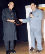 Vijay Chandar, receiving lifetime achievement award for his contributions to Telugu movies