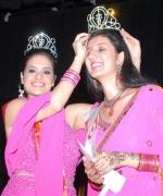 Neha Multani, Nisha Mirchandani, the outgoing queen, crowns the winner Neha Multani.