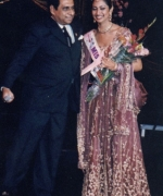 Stacy, receiving her prize from Dharmatma Saran