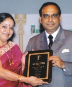 Mrs. Seema Andhare, Regional Director, Air-India, being honored by the Chairman Dharmatma Saran
