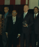 Recognizing Raymond Fredericks, Dharmatma Saran recognizing Raymond Fredericks, President of JFK Hospital and committee members of Dr. G.N. Roy Cancer Fund