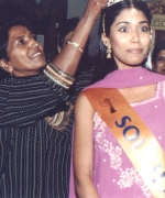 Hair Stylist Shirley Naidoo, crowning Miss Beautiful Hair Sareka Sukhdeo of South Africa