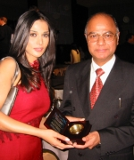 Yogesh D. Mathur, Regional Director of Air India being honored by Anupma Verma for Air India continued support to Miss India Worldwide Pageant