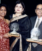 "Lifetime achievement award, Neelam & Dharmatma Saran recieving a lifetime achievement award ""For Bringing The International Indian Community On One Platform Through Pageantry"" from Shirley Naidoo"