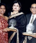 "Lifetime achievement award, Neelam & Dharmatma Saran recieving a lifetime achievement award ""For Bringing The International Indian Community On One Platform Through Pageantry"" from Shirley Naidoo"