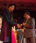 Honoring, Dharmatma Saran honoring Anil Ramhit Doebe of SurIndia Glamour