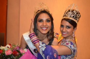 Monica Gill being crowned by outgoing queen, Nehal Bhogaita